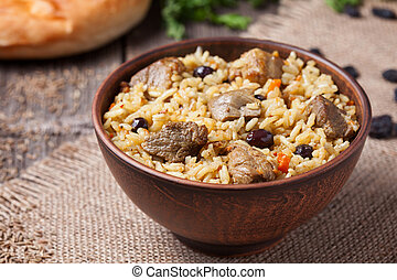 Bowl of hot traditional Arabic national rice food called...