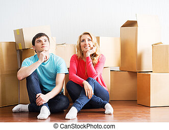 Young couple moving in a new home - Young and happy couple...