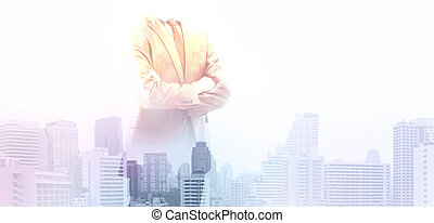 Businessman on a city background - Successful businessman...