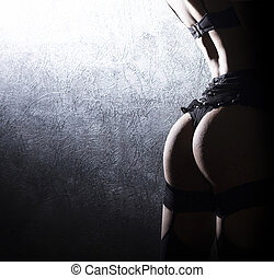 Shadow silhouette, of sexy woman in erotic lingerie.