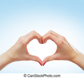 Female hands in shape of a heart - Beautiful female hands in...