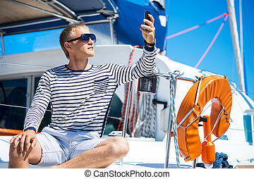 Young man on a sailing boat - Young and handsome man on a...