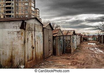 Vandalized Garages and Dark Spring Skies - Old metal garages...