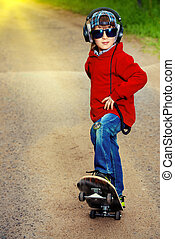 freetime - Modern boy with his skateboard on the street....