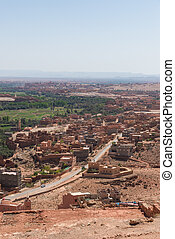 The road and houses in Tinghir city, Morocco - The road and...
