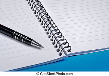Pen and notebook on background