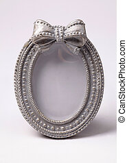Ornate oval shape picture frame on white background