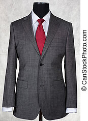Dummy on white background. Gray suit