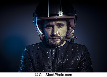 Racer, biker with motorcycle helmet and black leather...