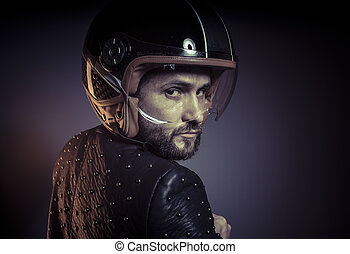 biker with motorcycle helmet and black leather jacket, metal...