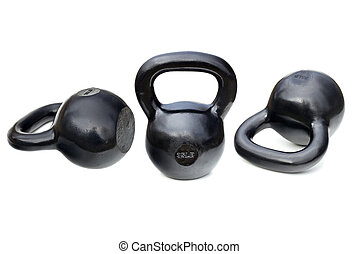 black shiny heavy kettlebells - three black shiny 35 lb iron...