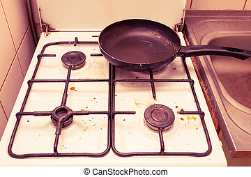 Dirty grubby gas stove in kitchen - Housework, hygiene and...