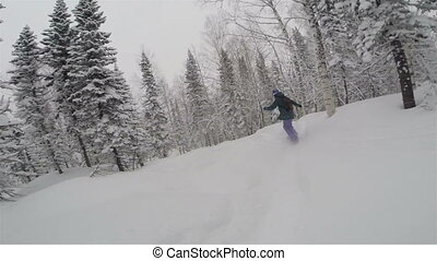 Freeriding on snowboard on powder day