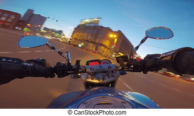 Riding a motorcycle in a city