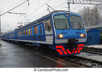 electric passenger train in the station in winter
