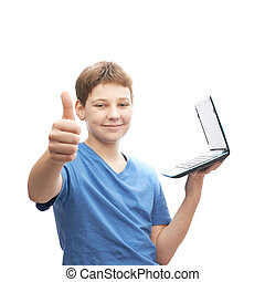 Young boy with a small notebook computer - Young boy in a...