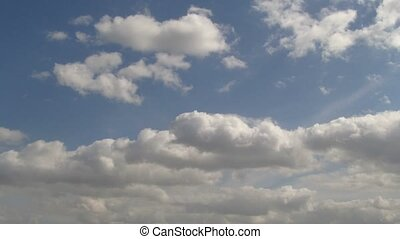 Blue spring sky with flying fluffy clouds timelapse UHD 4K...