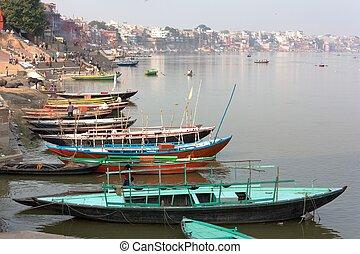 View of Varanasi with boats on sacred Ganga River - Uttar...