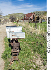 Mail boxes on a country raod with barn - Rustic barn and...