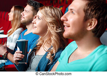 Woman with coke in cinema between viewer - Carry away...
