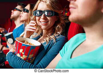 Woman in 3 d glasses eating popcorn. - 3 d world. Pretty...