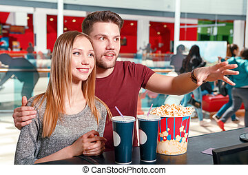 Couple buying popcorn and coke - Lets take everything....