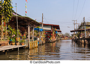 Ratchaburi town - hovels of a small village on the riverside...