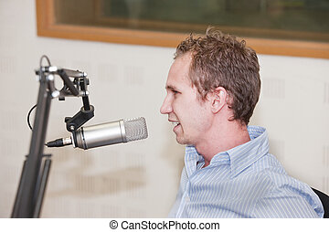 radio guy - young Caucasian male in front of the microphone...