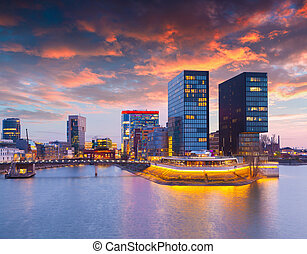 Colorful spring sunset of Rhein river at night in Dusseldorf...