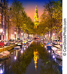 South Church Zuiderkerk and Amsterdam Canals at dusk Night...