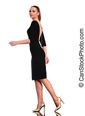 elegant business woman walking - Full body picture of a...