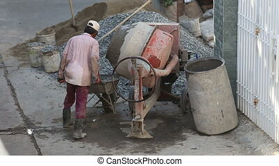 man drives up takes cement solution out of mixer and goes...