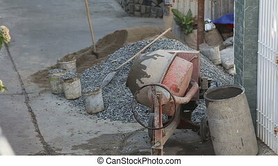 concrete mixer mixes cement solution in street