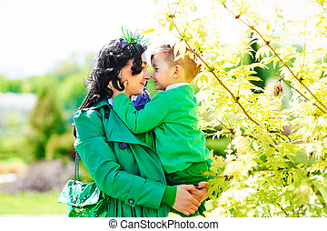 modern stylish happy mother holding little son - modern...