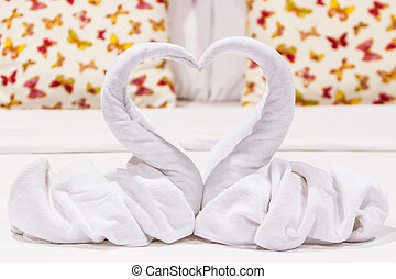 Two swans heart shaped made from towels. - Two swans heart...
