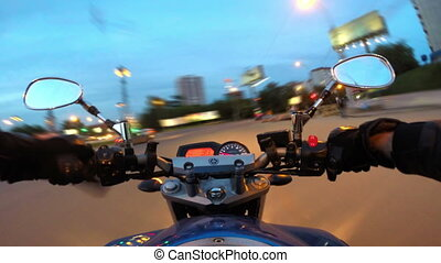 Riding a motorcycle in a city, timelapse