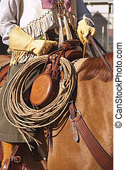 western saddle and gear - closeup of the western saddle with...