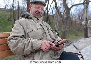 Senior man with a tablet