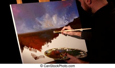 Stylish painter goes on drawing a new painting with sky and...
