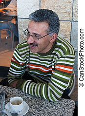 iranian man - Iranian Arabic man, having a rest at a coffee...