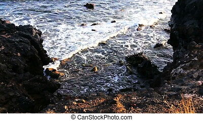 Waves and stones on coast or shore of the Atlantic ocean...