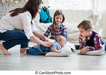 Happy family having fun on floor of in living room at home
