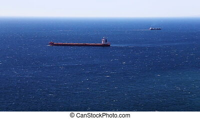 Cargo ship in the open ocean - Cargo ship in the open...