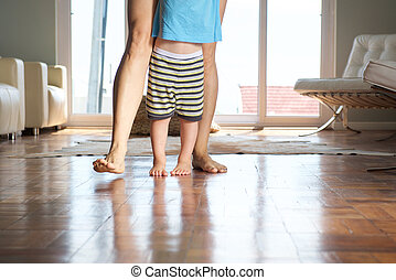 Mother walking with little boy at home