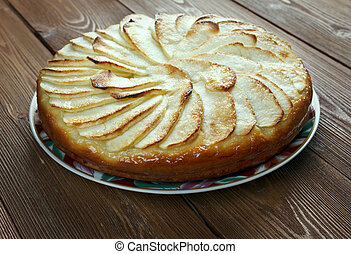 Tarte Normande - variant apple tart made in Normandy filled...