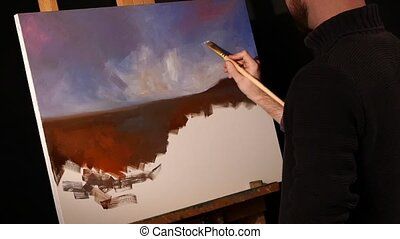 Stylish painter goes on drawing a new painting with oil...