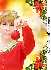 Happy Christmas - woman holding red bauble