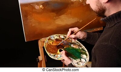 Talanted painter, dark sweater starts drawing an object on...