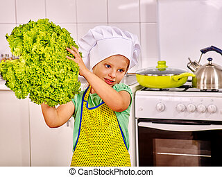 Child cooking at kitchen.