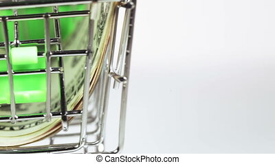Dollars in cart - In trolley from supermarket stack of...